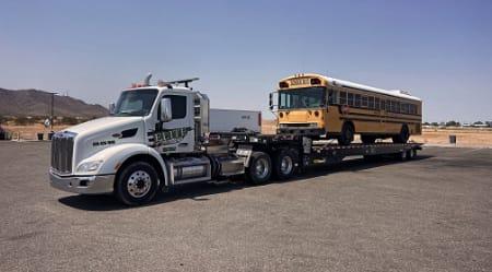 school bus getting towed