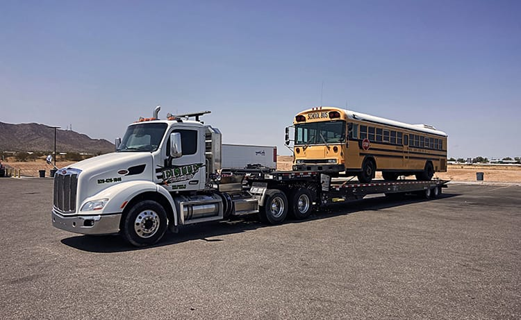 tow truck towing a school bus